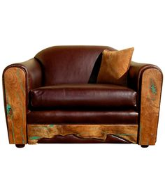 Mesquite wood with turquoise inlay accentuates the southwest feeling of this ultra soft leather club chair. Each one will have a unique shape to the wood edge along the kick plate in front.
