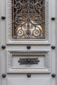 Fabulous, fabulous French Country details.  Love the French grey and ornate artistry of the ironwork!!