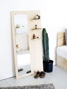 anthologymag-blog-diy-amerrythought- plain wood organizer with mirror propped against wall