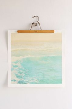 This is a cool idea to try as a DIY like buy some old hanger and print a photo off the internet that you like. [Myan Soffia Surge Art Print]