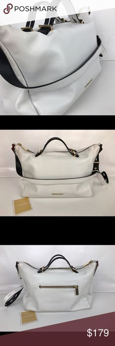 """Michael Kors Chelsey Large Conv Shoulder Bag Condition: New, with tags. A few very light signs of handling on exterior and interior. See photos.   A stunning bag in black and white! Michael Kors smooth-leather shoulder bag. Golden hardware. Convertible, flat shoulder strap- where as a shoulder or cross body; 12.5"""" drop. Zip top. Inside, fabric lining; one zip, one cell phone, and three open pockets with key chain. Back zip pocket. 9.5""""H x 14""""W x 7""""D. Style 30S6GC0L3T. Our Bag # RB135  Thank…"""
