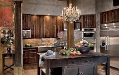 I want to marry Gerard Butler just for his fabulous kitchen. Adore the chandelier. (Not my comment, I got a hot hubby but he'd be next in line). Ha-ha!~AD
