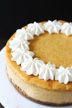Pumpkin Cheesecake with Brown Butter Gingersnap Crust Recipe on twopeasandtheirpod.com This creamy and rich pumpkin cheesecake is the BEST dessert! Add it to your Thanksgiving menu!
