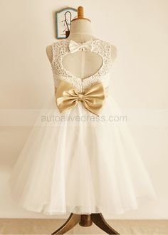 The dress is made of high quality of lace,satin and tulle fabric.The listed color is ivory with champagne sash/bow.It features the keyhole back and has 2 bows at back.It is in knee length.Perfect for wedding,holiday,photo shoots or baptism. For Custom Dress, please enter the measurements at Custom N