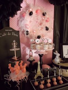 I'm in love with the boa wreath and the pink cake pops...you could go over the top with a theme like this!