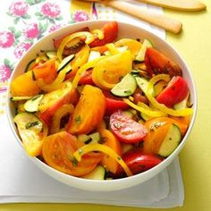 Heirloom Tomato & Zucchini Salad Recipe from Taste of Home | Tomato wedges give this salad a juicy bite. It's a great use of fresh herbs and veggies from your own garden or the farmers market.