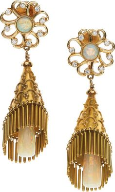 Opal, Diamond, Gold Earrings -  The earrings feature opal cabochons and opal pendulums, enhanced by full-cut diamonds weighing a total of approximately 0.64 carat, set in textured 14k gold, completed by posts and omega clips on the reverse. Gross weight 24.20 grams. Dimensions: 2-1/2 inches x 3/4 inch   The Property of the Margaret Nichols Trust