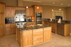 Traditional Light Wood Kitchen Cabinets (Kitchen-Design-Id.) Traditional Light Wood Kitchen Ca Wood Kitchen Cabinets, Granite Kitchen, Kitchen Tiles, Kitchen Flooring, Kitchen Countertops, Marble Countertops, Tile Flooring, Dark Counters, Staining Cabinets