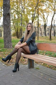 Leggy beauty making the best of a modeling session ruined by the ugly run in her stockings
