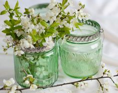 .using vintage bottles with wild flowers for your centerpieces are absolutely perfect.