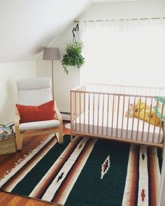 Gender neutral earthy nursery. Paint color: Simply White