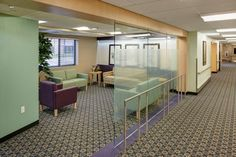 A semi-transparent wall of glass surrounded by a bulkhead creates a space for the entry lounge. Fleur Heights Care Center. Photo: Cameron Campbell, Integrated Studio.