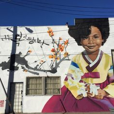 Korean Graffiti Artist Creates Stunning Murals of Black Women in Traditional Korean Dress