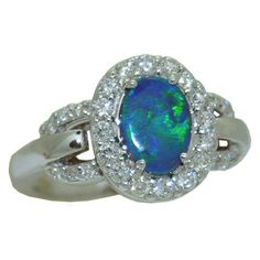 Opal Ring with 0.54 cttw. Diamonds https://www.goldinart.com/shop/colored-gemstone-rings/opal-ring-0-54-cttw-diamonds #14KaratWhiteGold, #OpalRing