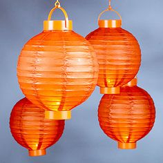 Battery-powered paper lanterns from World Market.  Can be placed on a table or hung from lattice and trees.