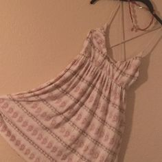 Free People Summer Dress This is a really cute, comfortable, thin strapped, cross-back FP Dress.  Perfect worn with flats or heels and great to take on a trip as it packs well and hardly wrinkles. Free People Dresses Mini