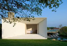 Piracicaba House by Isay Weinfeld  The first floor, which houses the bedrooms, sits above the kitchen and services with a roof terrace formed over the other wing.