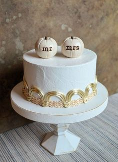 Mini white pumpkins as cake toppers for a fall wedding cake? We're all in!