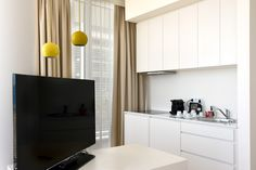 Kitchen and living area with dining table in our apartments with access to outside private big terrace