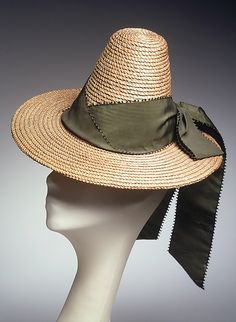 Hat  Sally Victor  (American, 1905–1977)    Date:      1938  Culture:      American  Medium:      Straw, silk  Credit Line:      Brooklyn Museum Costume Collection at The Metropolitan Museum of Art, Gift of the Brooklyn Museum, 2009; Gift of Sally Victor, Inc., 1944