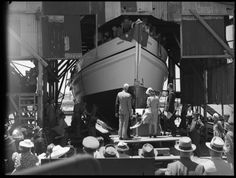 226611PD: Miss June Fernie, daughter of the Director of Industrial Development (Mr N. Fernie) christening the vessel Eureka. On her left is the general manager in Australia of Millars Timber & Trading Co. (Mr N. Temperley), 27 November 1945.  http://encore.slwa.wa.gov.au/iii/encore/record/C__Rb2380818__S226610PD__Orightresult__U__X3?lang=eng&suite=def
