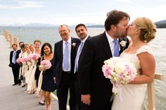 The wedding party on the pier in North Lake Tahoe. Planning and Design by One Fine Day Events. Photography by Fiona Sarn.