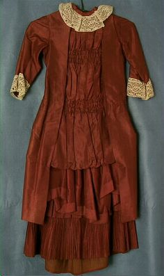 1883-1885 Girl's Dress, brown silk, ivory lace, and smocking via Wisconsin Historical Society