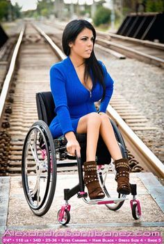 Alexandra Santibanez is a Hispanic model and motivational speaker who uses a wheelchair. She was injured in a car accident that left her with a T3 spinal cord injury, paralyzing her from the waist down. She didn't let that stop her, continuing on with life. She eventually got a bachelor's in Fashion Merchandising. She has participated and won several fashion/beauty pageants and currently models for a line of handbags and Team Colours, a company that sells customized wheelchairs.