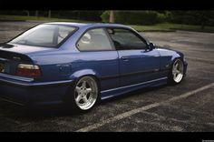 Estoril blue BMW e36 coupe slammed on cult classic OZ AC Schnitzer type 1 wheels