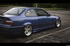 Estoril blue BMW e36 coupe slammed on cult classic OZ AC Schnitzer type 1 wheels