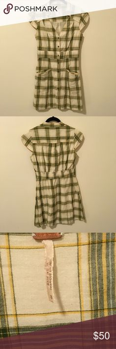 FREE PEOPLE Cream & Green Plaid Button Down Dress Free People Green and cream colored Plaid dress with a Button Down center front and a flat collar and short sleeves! Super soft cotton like fabric and has a small dark mark on the shoulder as photographed. Needs a dry cleaning or a wash and hang dry! Size 8. Free People Dresses