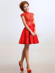 This red and gold keyhole a-line knee length dress is a versatile formal dress that can be worn to many special occasions. Whether you 're looking for a dress to wear to prom, cocktails with friends, a wedding or hot date, this a-line dress is a great choice. Only the finest tapestry satin is used to create this gorgeous dress.
