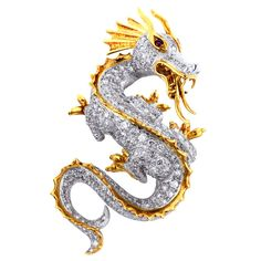 McTEIGUE Diamond Dragon Pin, Platinum and 18 karat yellow gold vintage dragon pin with pendant option consisting of round brilliant cut diamonds accents having a total weight of approximately carats, and ruby eyes signed Mcteigue circa Antique Jewelry, Vintage Jewelry, Dragon Jewelry, Dragons, Bling, Animal Jewelry, Statues, Gemstone Jewelry, Diamond Cuts