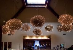 tumbleweed chandeliers... no lights, paint them all.. or not... and have lights above