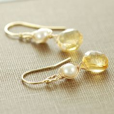 Warm yellow faceted citrine brioletts dangle below pearls wrapped with 14k gold fill wire, dangling from 14k gold fill earwires. These gemstone earrings work wonderfully for casual or dressy looks, and the lovely colors blend seamlessly from winter to spring. Total length is approximately 1