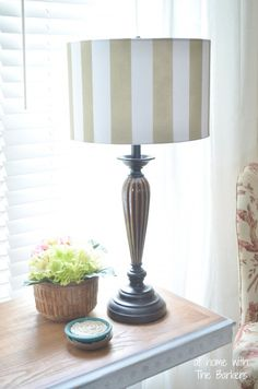 Basic stripes and a can of spray paint are all you need for an easy to this lampshade.  Do it yourself with the easy to follow tutorial.