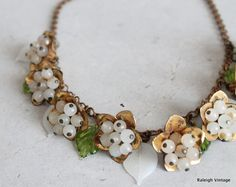 Vintage 1930s Necklace : 30s 40s Brass and Glass Bell Flower Choker.  via Etsy.