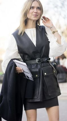 Paris Fashion Week street style: a belted leather vest worn over a classic white button down and black mini skirt