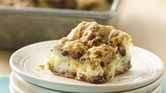 Chocolate Chip Cheesecake Bars - The best of all possible worlds -- creamy cheesecake filling on a chocolaty crust made easy with Pillsbury® cookie dough.