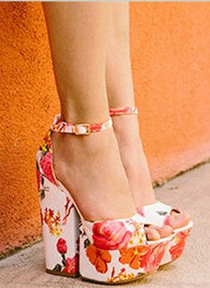 These floral heels are gorgeous, but I think I would prefer them as the traditional wedge.