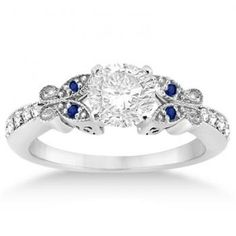 This sapphire engagement ring features a unique butterfly design and comes with blue sapphires and diamonds.