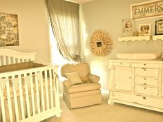 A sophisticated monochrome nursery look in off white.  Very vintage!