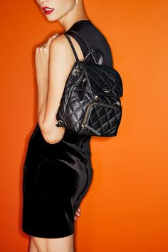 Plush quilted leather brings out the sophisticated side of this @katespadeny    backpack. A diminutive take on one of the season's most coveted silhouettes, this downtown darling is exclusively ours.