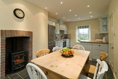 The open plan kitchen/diner complete with log burner Small Farmhouse Kitchen, Open Plan Kitchen Diner, Cottage Kitchens, Country Kitchen, New Kitchen, Kitchen Dining, Farmhouse Kitchens, Dining Room, Oliver House