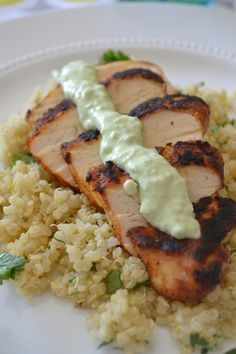 Blackened chicken with cilantro lime quinoa and avocado cream sauce.