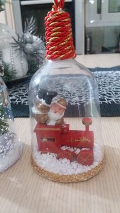 DIY Christmas tree ornament from plastic wine glass. Santa Claus playing around in his private train. Beautiful Christmas DIY for kids