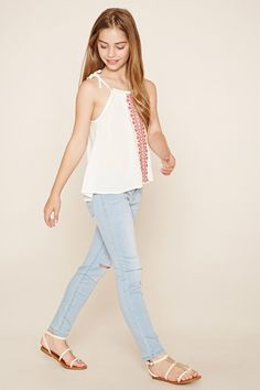 Forever 21 Girls - A woven cami featuring a baroque embroidery on the front, a round neckline, self-tie spaghetti straps, and an elasticized ruffle collar.