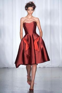 Maybe am just really feeling red for this fall (although this is for next year spring) but that Deep burgundy colour, That princess crown bustline and that whole look makes me swoon. Simple but so elegant.