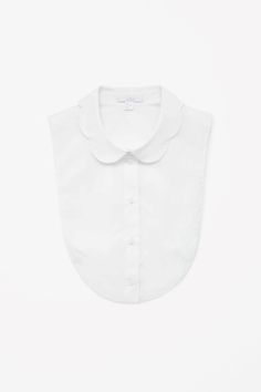 Made from crisp cotton, this mock shirt is a curved bib shape with a scalloped collar. Designed to be layered under tops, giving the illusion of a shirt, it has subtle elastic straps to keep it in place. Fashion Capsule, Fashion Outfits, Minimalist Fashion, Minimalist Outfits, Minimalist Style, Collar Shirts, Collars, Slow Fashion, Dress Codes