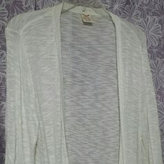 White sweater White, light weight sweater, shirring on bottom part of sleeves and gathered detailing on the back waist. Open look. Only worn few times. XXL but fits more like a large. That's why I put large in the size category. Faded Glory Sweaters Cardigans